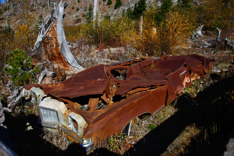 "This is known as the Miner's Car. It was a 1972 green Pontiac Grand Prix. The family hiked and later died in a miner's cabin nearby. This car was supposedly in the safer ""Blue Zone"" which was open to those conducting business under a permit if they signed a liability waiver with the state. The car remained after the blast."