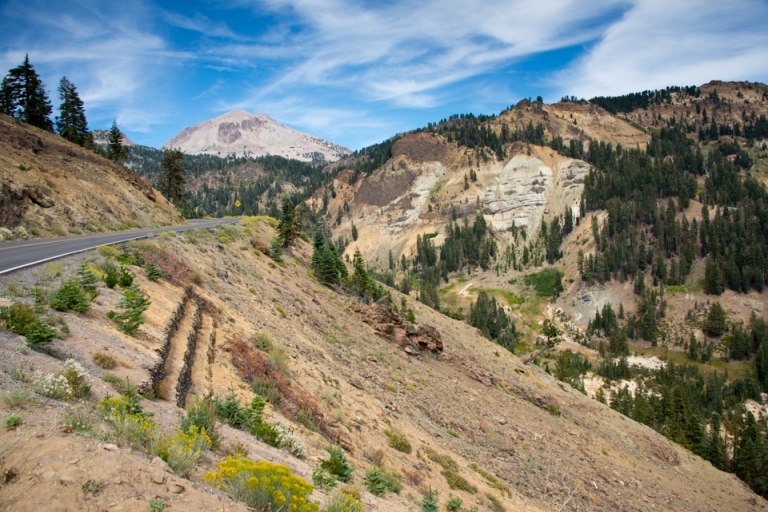 Volcanic tuff and ash deposits litter the park as you drive toward the summit of the volcano.